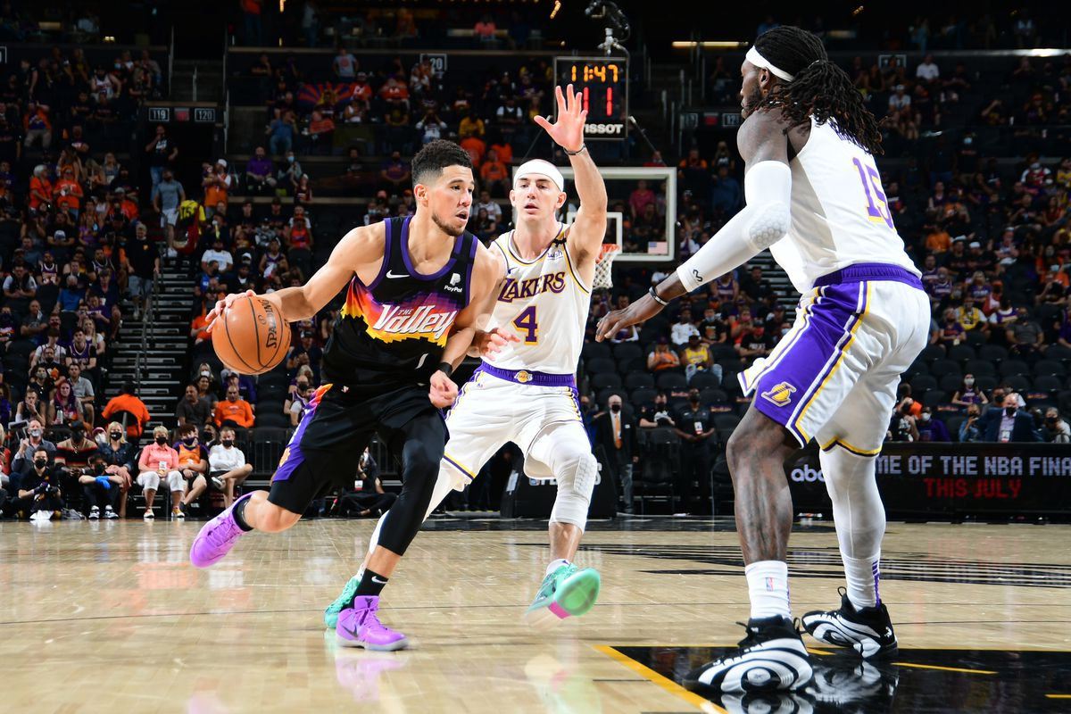 Devin Booker of the Phoenix Suns drives to the basket against the Los Angeles Lakers during Round 1, Game 1 of the 2021 NBA Playoffs on May 23, 2021 at Phoenix Suns Arena in Phoenix, Arizona.