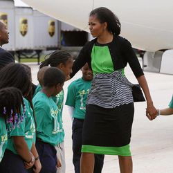 First lady Michelle Obama is greeted by students from Y.E. Smith elementary Museum School as she arrives in Raleigh, N.C., Wednesday, Sept. 19, 2012.