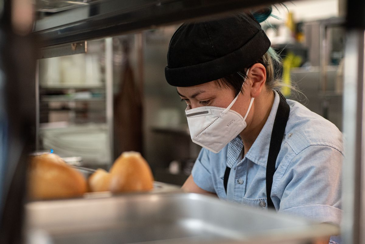 Chef Uyen Le working on the line at her restaurant Be U in Los Angeles.