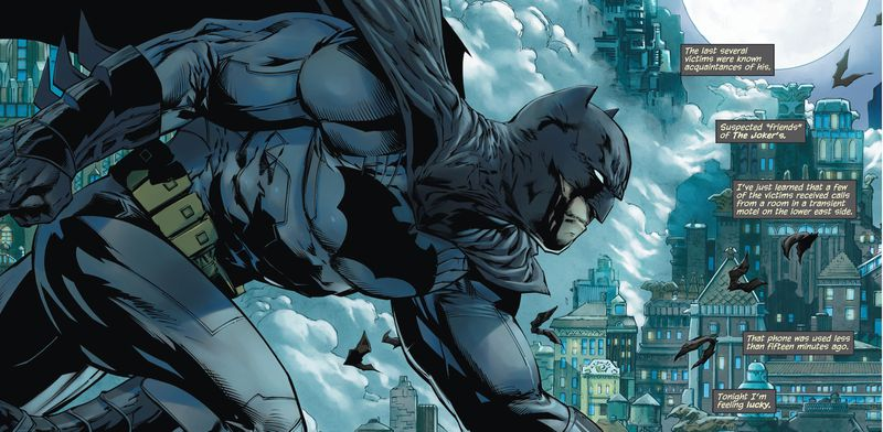 Batman scowls while dashing over city rooftops. His costume has lots of trim lines all over it, with bulky gloves and short ears, in Detective Comics #1, DC Comics (2011).