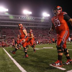 Utah Utes offensive lineman Orlando Umana (50) and teammates warm up before the game against the Colorado Buffaloes at Rice-Eccles Stadium in Salt Lake City on Saturday, Nov. 25, 2017.