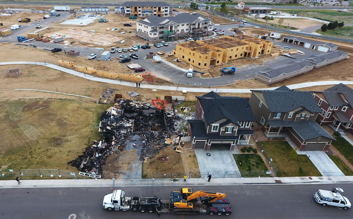 A gas well, in the upper left, covered by tan fencing is less than 200 feet from a home that suffered a fatal house explosion on April 27, 2017 in Firestone, Colorado.