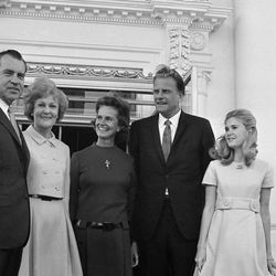 President  Richard Nixon and Pat Nixon stand at the White House North Portico on Jan. 26, 1969 in Washington with evangelist Billy Graham and his wife Ruth after a church service in the East Room. At right is Nixon's daughter Tricia.  The President, a Quaker, plans on inviting pastors of different religions to officiate at the weekly services for his family and invited guests. (AP Photo/Harvey Georges)