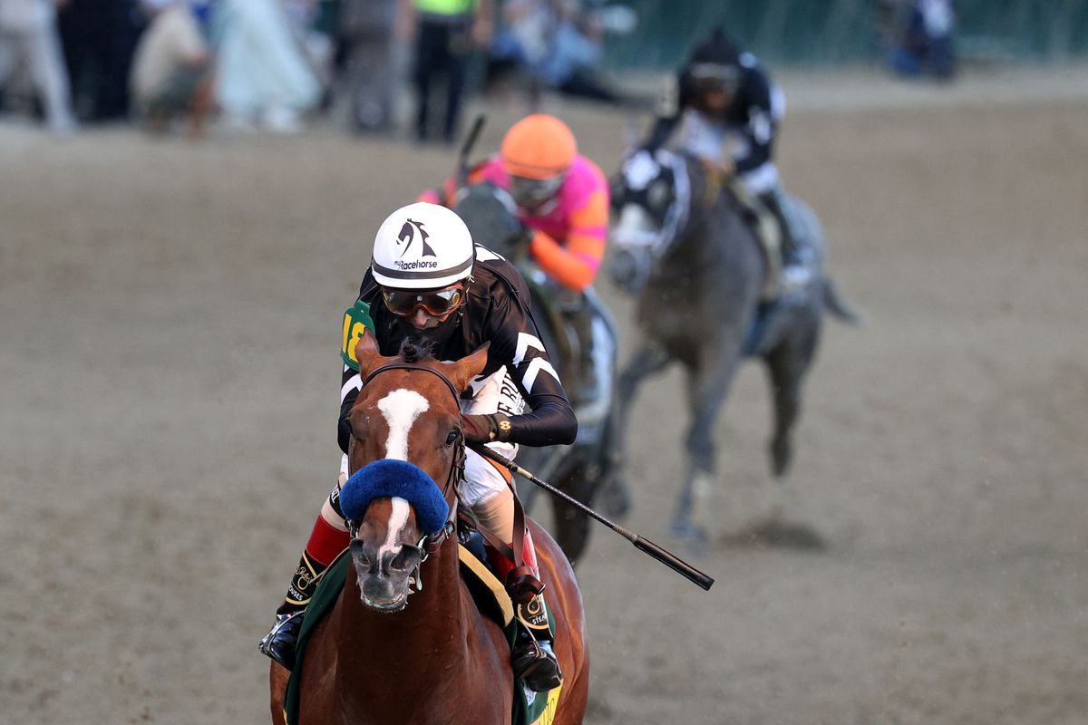 Authentic, ridden by jockey John Velazquez, crosses the finish line to win the 146th running of the Kentucky Derby at Churchill Downs on September 05, 2020 in Louisville, Kentucky.