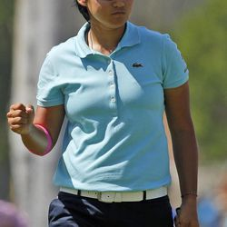 Yani Tseng, of Taiwan, celebrates a birdie on the fourth hole during the third round of the LPGA Kraft Nabisco Championship golf tournament in Rancho Mirage, Calif., Saturday, March 31, 2012.