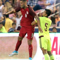 United States midfielder Clint Dempsey (8) and Venezuela's Francisco Flores (5) reach for a header during a soccer game at Rio Tinto Stadium in Sandy on Saturday, June 3, 2017.