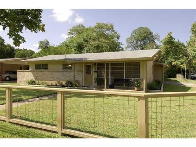 1967 midmod brick facade house with yard and front cattle-panel fence