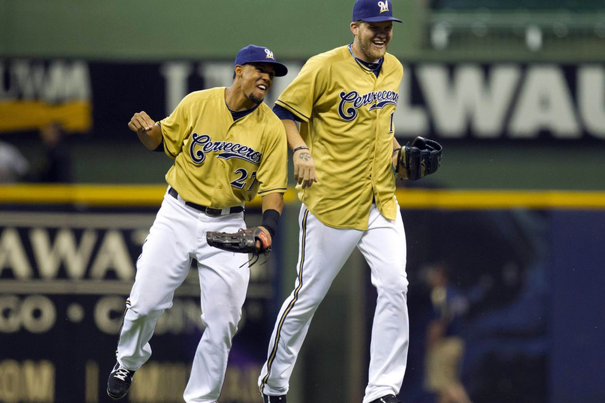 June 2, 2012: Milwaukee, WI, USA;  Milwaukee Brewers center fielder Carlos Gomez (27) and right fielder Corey Hart (right) celebrate following the game against the Pittsburgh Pirates at Miller Park.  Mandatory Credit: Jeff Hanisch-US PRESSWIRE