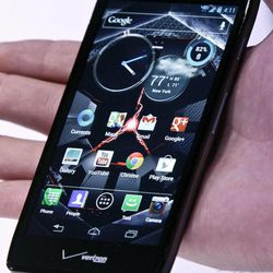 The new Droid Razr Maxx HD is reviewed during a press conference on Wednesday, Sept. 5, 2012.  It's one of three new smartphones unveiled by Motorola since it became a part of Google.