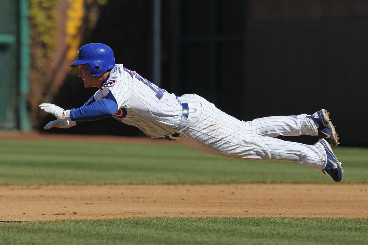 Darwin Barney of the Chicago Cubs dives safely into 2nd base against the Milwaukee Brewers at Wrigley Field in Chicago, Illinois. (Photo by Jonathan Daniel/Getty Images)