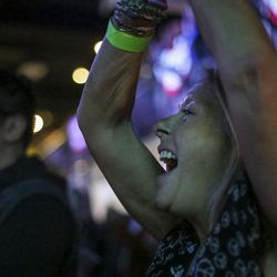 """A woman cheers during the """"Come Together and Fight Back"""" tour with Vermont Sen. Bernie Sanders and Democratic National Committee Chairman Tom Perez at the Rail Event Center in Salt Lake City on Friday, April 21, 2017. About 3,000 people attended the event."""