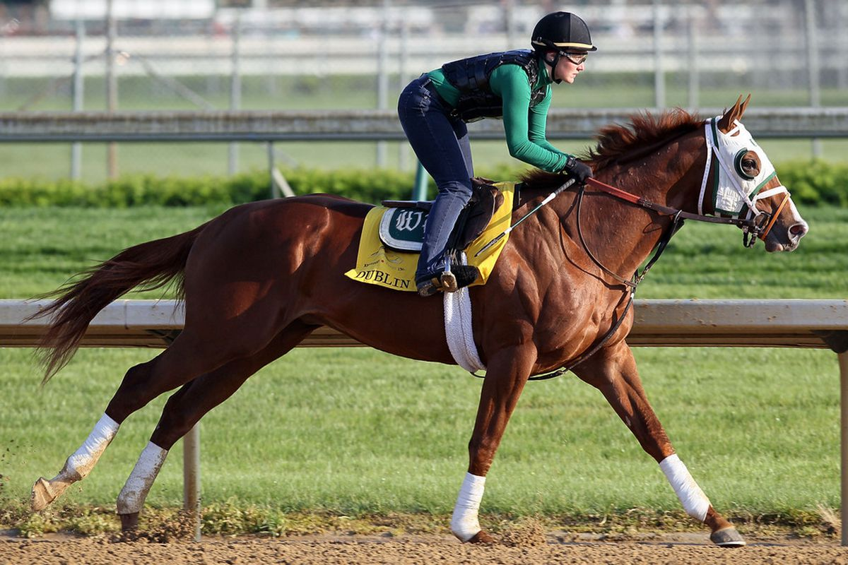 LOUISVILLE, KY - APRIL 28: Dublin with exercise rider Arielle Witkowski aboard runs on the track during the morning workouts for the Kentucky Derbyat Churchill Downs on April 28, 2010 in Louisville, Kentucky. (Photo by Andy Lyons/Getty Images)