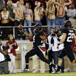 Stanford's Drew Terrell, center, runs down the sideline on a 76-yard punt return for a touchdown against Duke during the first half of an NCAA college football game in Stanford, Calif., Saturday, Sept. 8, 2012.