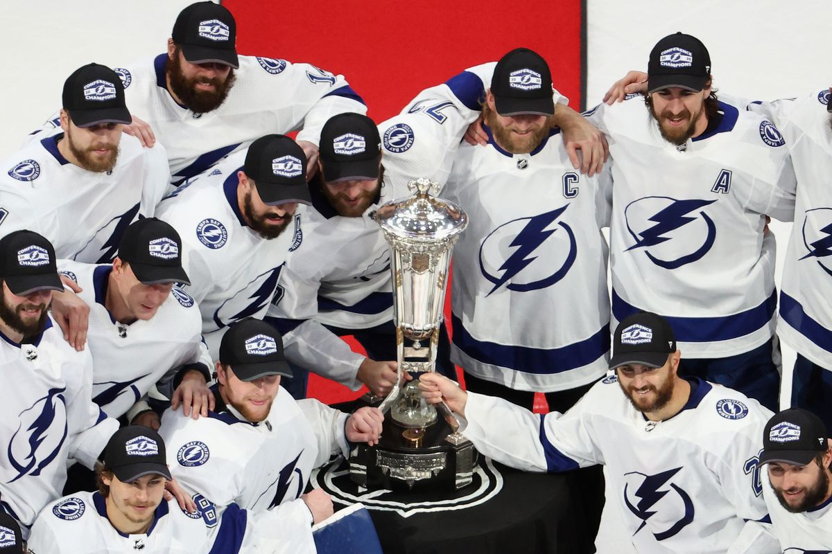 Tampa Bay Lightning players hold on to the Prince of Wales Trophy following the series win over the New York Islanders in the first overtime period in Game Six of the Eastern Conference Final during the 2020 NHL Stanley Cup Playoffs at Rogers Place on September 17, 2020 in Edmonton, Alberta, Canada.