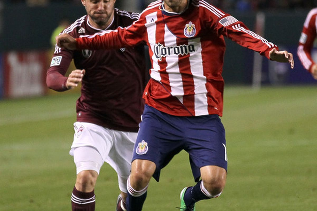 CARSON, CA - MARCH 26:   Blair Gavin #18 of Chivas USA fights for the ball with Jamie Smith #20 of the Colorado Rapids at The Home Depot Center on March 26, 2011 in Carson, California.  The Rapids won 1-0.  (Photo by Stephen Dunn/Getty Images)