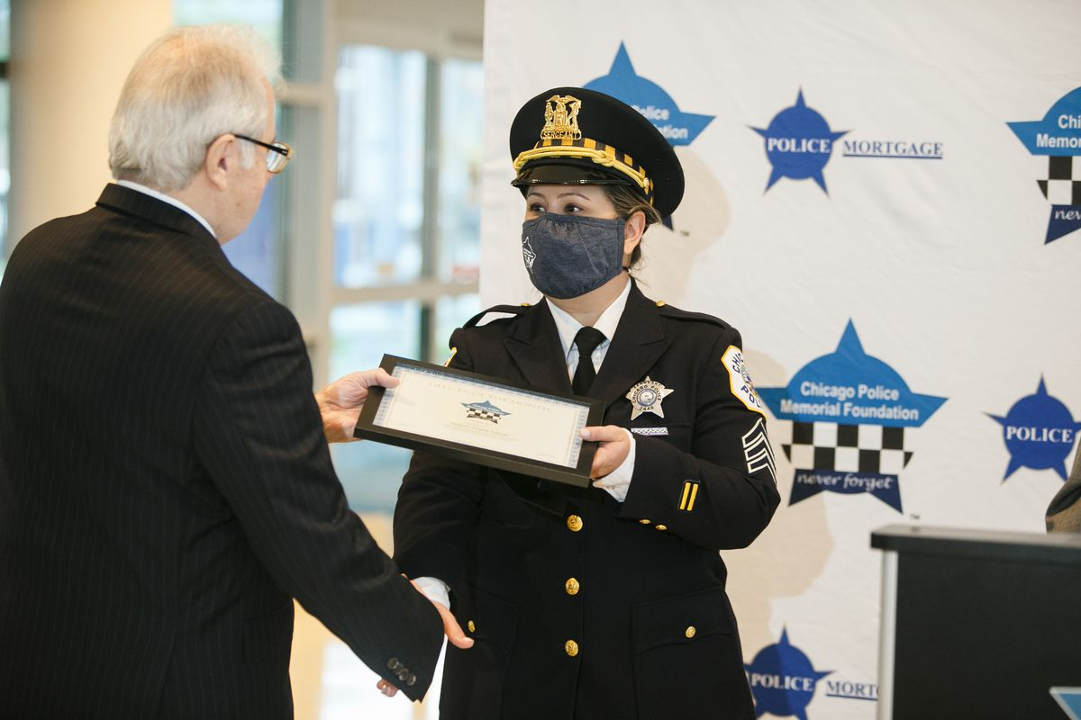 """Salgado said the incident was """"the scariest night of her life."""" Angela Salgado receives her award at the Chicago Patrolmen's Federal Credit Union in West Loop, Tuesday morning, Oct. 12, 2021."""
