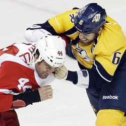 Detroit Red Wings right wing Todd Bertuzzi (44) fights with Nashville Predators defenseman Shea Weber (6) in the first period of Game 2 of an NHL hockey Stanley Cup first-round playoff series, Friday, April 13, 2012, in Nashville, Tenn.