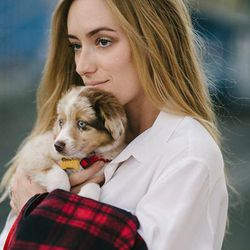 """<b>Kimberly Pesch</b> of <a href=""""http://www.eatsleepwear.com/""""target=""""_blank"""">Eat Sleep Wear</a> on her 12-week-old Mini Australian Shepherd, Lola: """"At 11 weeks, she was already ringing the bells on our door to go out to the bathroom. Genius little child"""