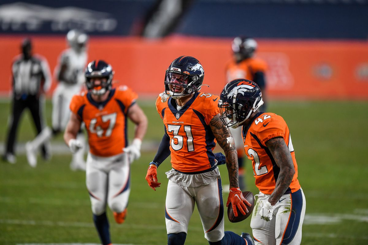 Denver Broncos free safety Justin Simmons (31) celebrates after a third quarter interception during a game between the Denver Broncos and the Las Vegas Raiders at Empower Field at Mile High on January 3, 2021 in Denver, Colorado.
