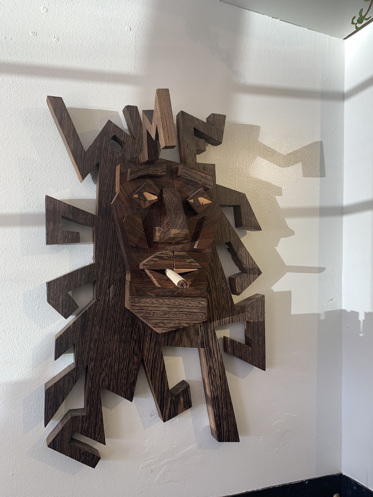 A mask on the wall of the cafe
