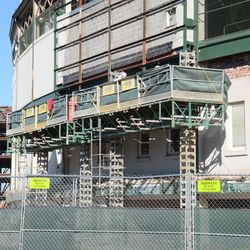10:42 a.m. Telescoping work platform set up in front of the ballpark, under the marquee -