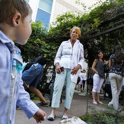 Dash Johnson, 4, left, a patient at Primary Children's Hospital, talks with his grandmother, Ruth Ann Johnson, during the reopening of the Angel Garden at the hospital in Salt Lake City on Monday, Aug. 1, 2016. The redesigned garden includes more than 1,000 new plants and trees, as well as legacy monuments, including the Butterfly Angel statue, a commissioned 5-foot bronze. Dash's family spearheaded renewal project.