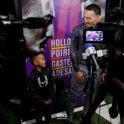 Max Holloway and his son answer questions at UFC 236 workouts.