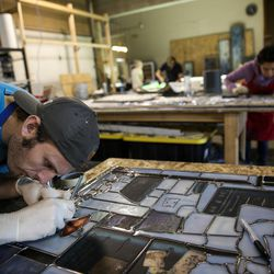 """Preston Powell works on """"The Roots of Knowledge,"""" a 200-foot-long stained glass installation for Utah Valley University, at Holdman Studios in Lehi on Friday, Nov. 4, 2016. The university announced a $1.5 million donation from philanthropists Marc and Deborah Bingham that will enable the completion of the massive stained glass installation."""