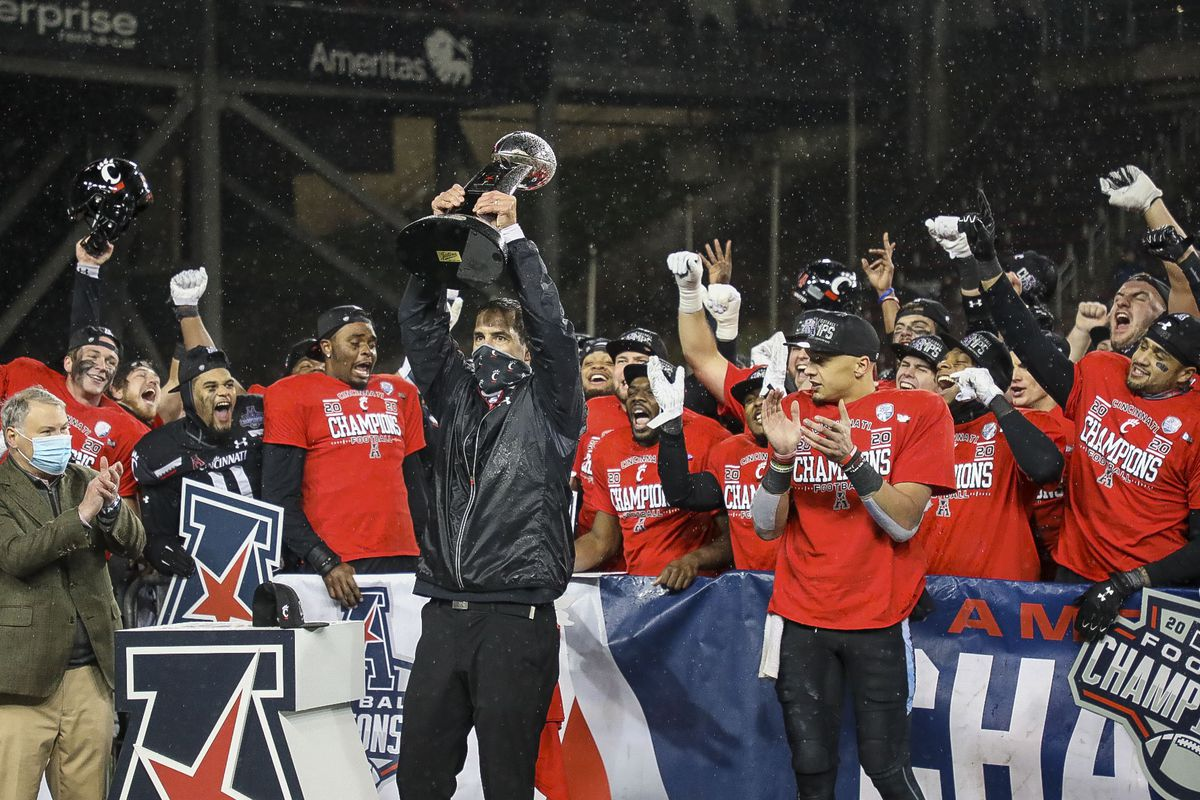 Cincinnati Bearcats head coach Luke Fickell holds up the AAC Championship trophy at the end of the game against the Tulsa Golden Hurricane at Nippert Stadium. Mandatory Credit: Katie Stratman