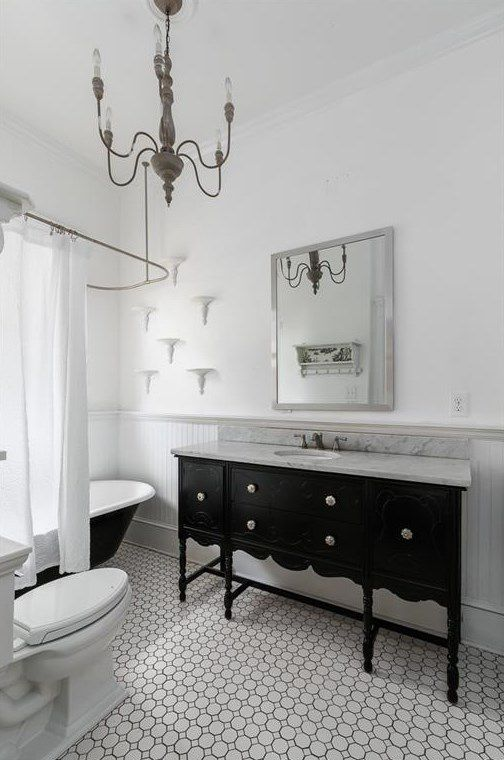 A white master bathroom with vintage vanity.