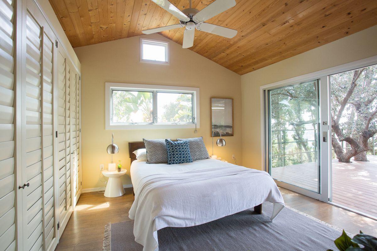 Bedroom with door leading to deck