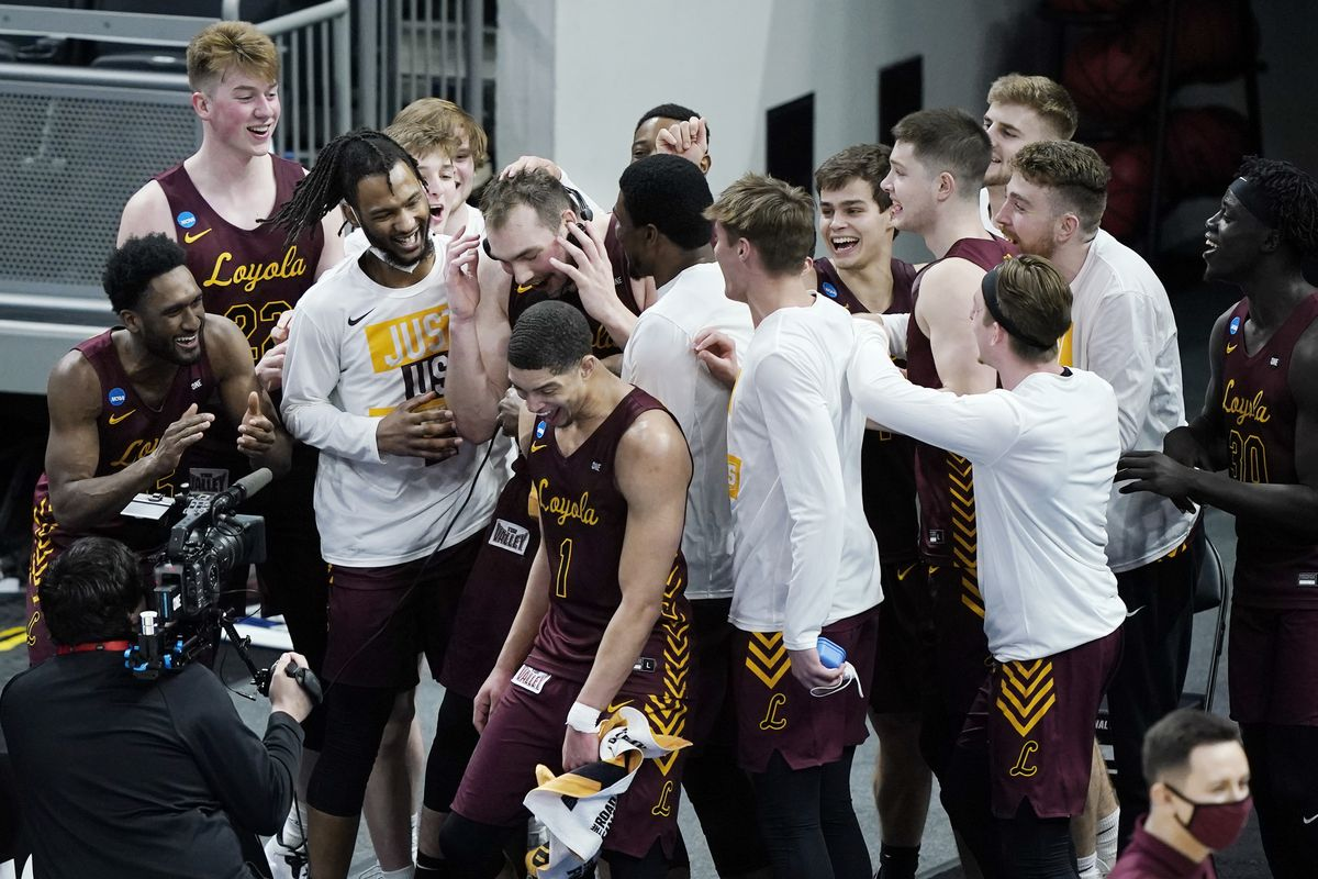 Loyola of Chicago players celebrate after beating Illinois in a college basketball game in the second round of the NCAA tournament at Bankers Life Fieldhouse in Indianapolis Sunday, March 21, 2021. Loyola upset Illinois 71-58.