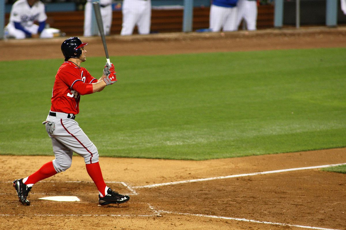 Apr 28, 2012; Los Angeles, CA, USA; Washington Nationals right fielder Bryce Harper (34) doubles during the seventh inning against the Los Angeles Dodgers at Dodger Stadium.  Mandatory Credit: Jake Roth-US PRESSWIRE
