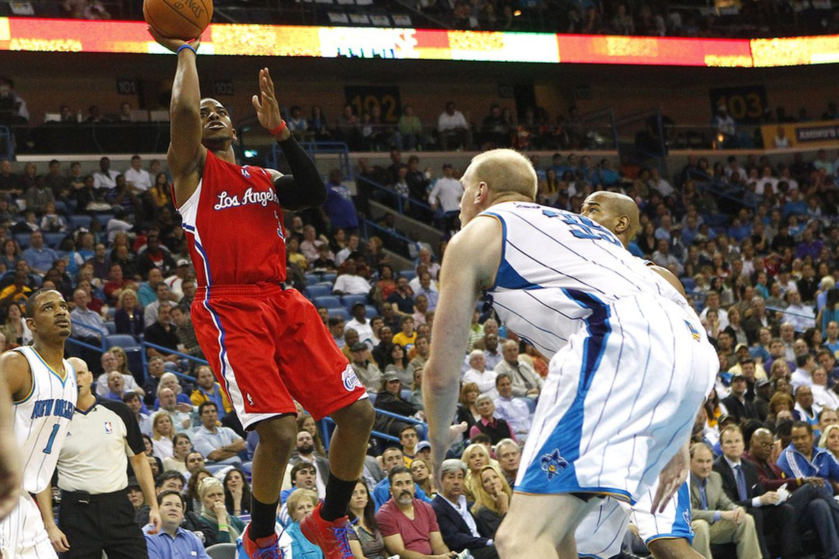 Mar 22, 2012; New Orleans, LA, USA; Los Angeles Clippers guard Chris Paul (3) goes up for a basket beside New Orleans Hornets center Chris Kaman (35) during the second quarter at the New Orleans Arena. Mandatory Credit: Crystal Logiudice-US PRESSWIRE