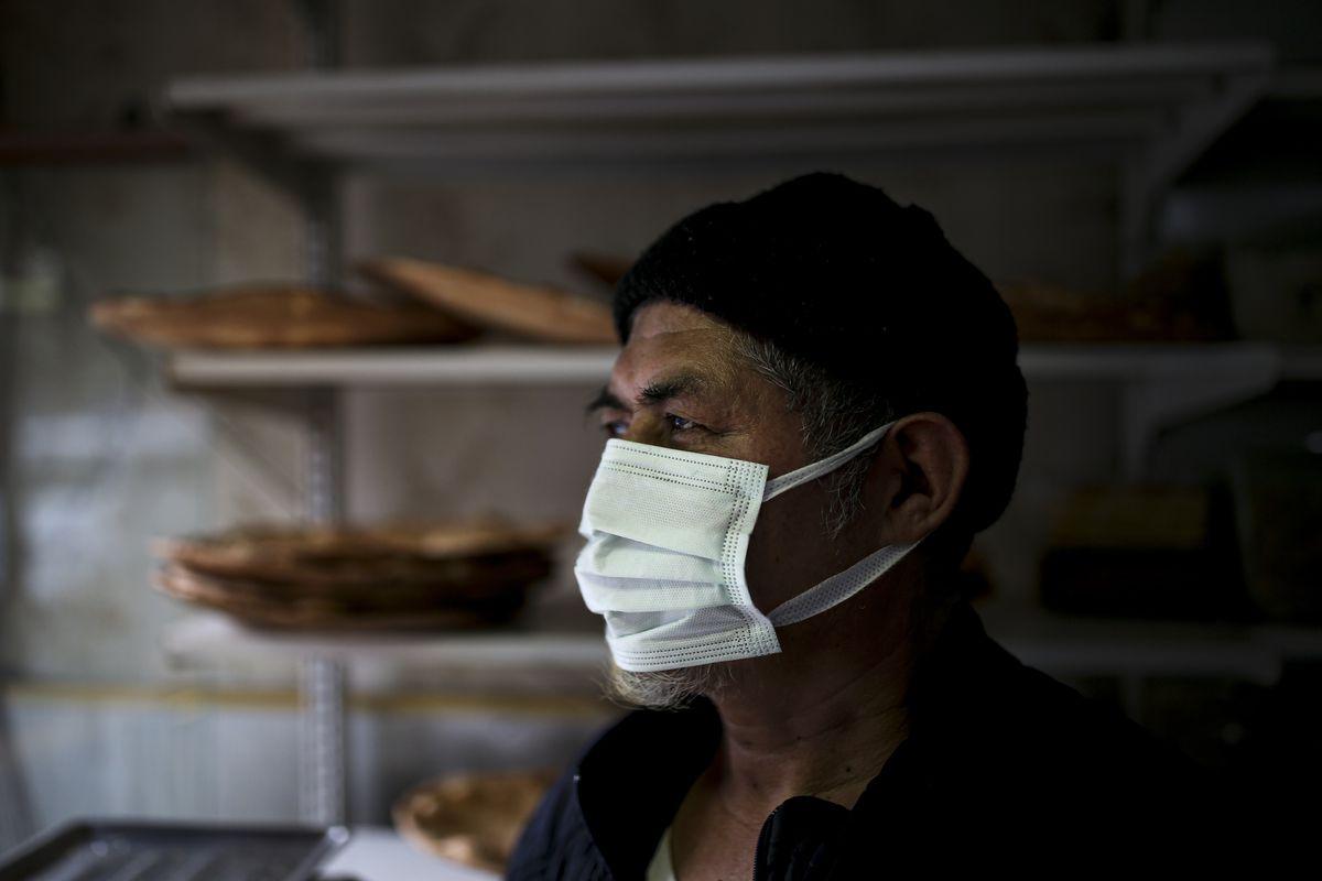 Muhammed Emin, a member of the Uighur community, looks outside in his bakery in Istanbul's Zeytinburnu neighborhood, Tuesday, Feb. 2, 2021.