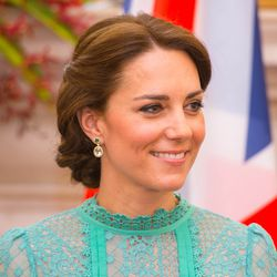 Kate's made-to-order earrings are by Kiki McDonough and cost about $5,000.