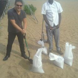 """The EMM Group makes its own sandbags. [<a href=""""https://www.facebook.com/photo.php?fbid=485207118168320&set=a.212470388775329.54188.183092825046419&type=1&theater"""">Facebook</a>]"""
