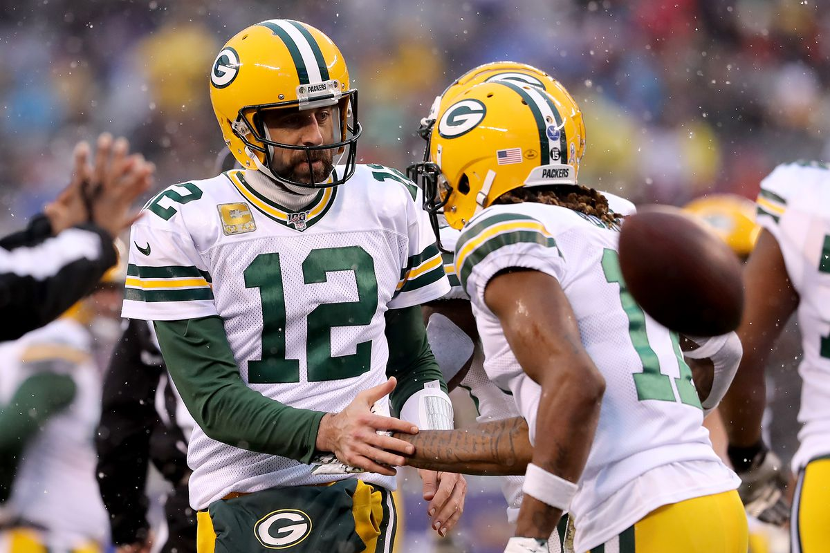 Aaron Rodgers of the Green Bay Packers congratulates teammate Davante Adams after Adams scored a touchdown in the first quarter against the New York Giants at MetLife Stadium on December 01, 2019 in East Rutherford, New Jersey.