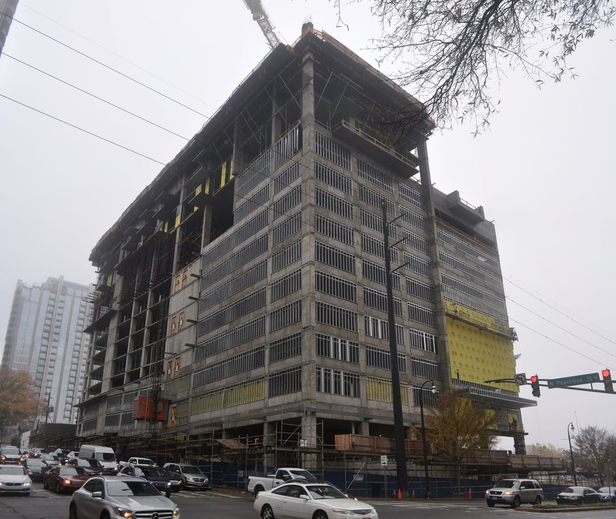 Construction of two blank walls proceeds, looming over the intersection of West Peachtree and 14th streets.