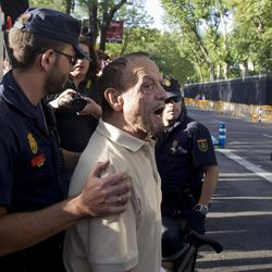 A demonstrator shouts as police lead him away during a protest against the visit by German Chancellor Angela Merkel in Madrid, Thursday Sept. 6, 2012.  Merkel and Rajoy met for talks on Spain's progress with crushing austerity measures. The government, which is struggling to pay punishingly high interest rates to raise money, is under pressure to accept a sovereign bailout.