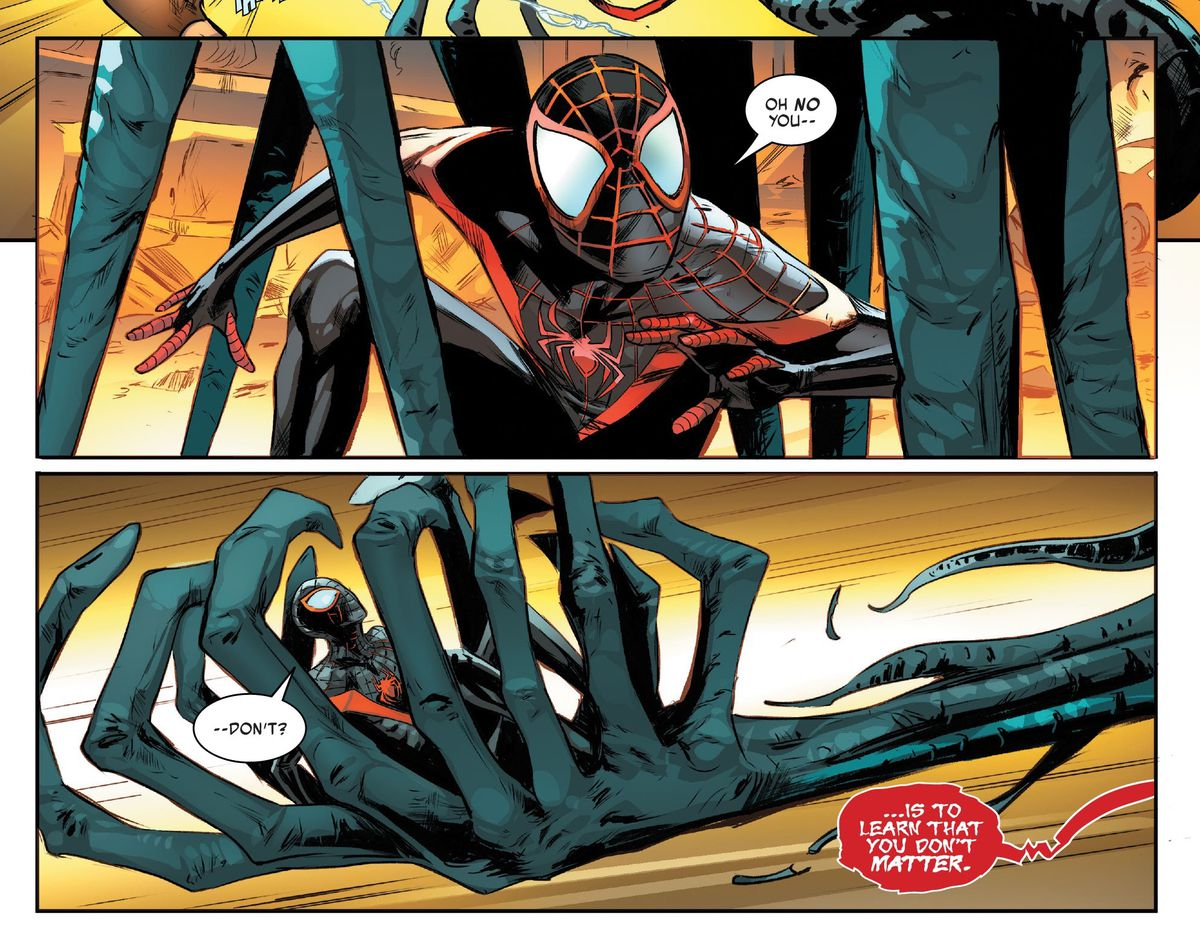 Miles Morales/Spider-Man is pinned down and the scooped up by a symbiote-merged Ms. Marvel's twelve clawed hand in Miles Morales: Spider-Man #23, Marvel Comics (2021).