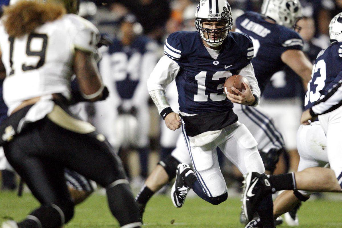 BYU quarterback Riley Nelson runs against Idaho.