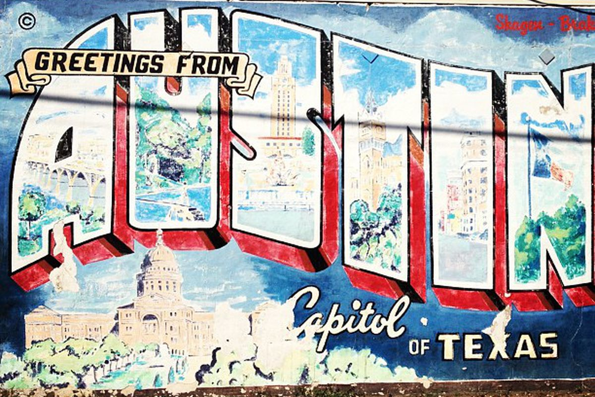 """A mural that reads """"Greetings from Austin, Capitol of Texas"""""""