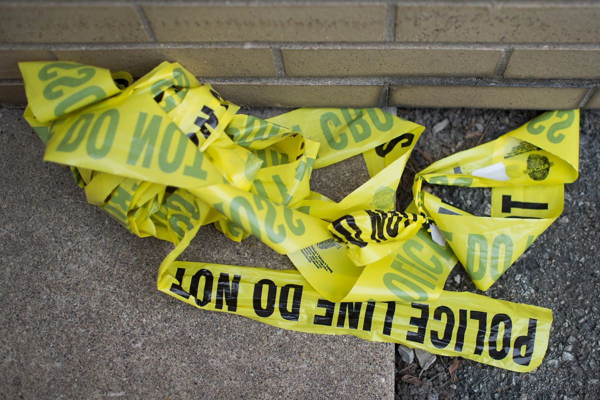 Wadded-up crime scene tape at the scene of a shooting where 1 person was killed and 4 injured in a Chicago park in 2016.