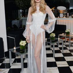 Gigi Hadid wore a Yanina Couture gown and Stuart Weitzman heels.