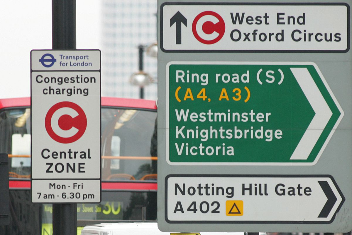 Road signs in central London include warnings about entering the Congestion Zone, for which private motorists must pay a fee.