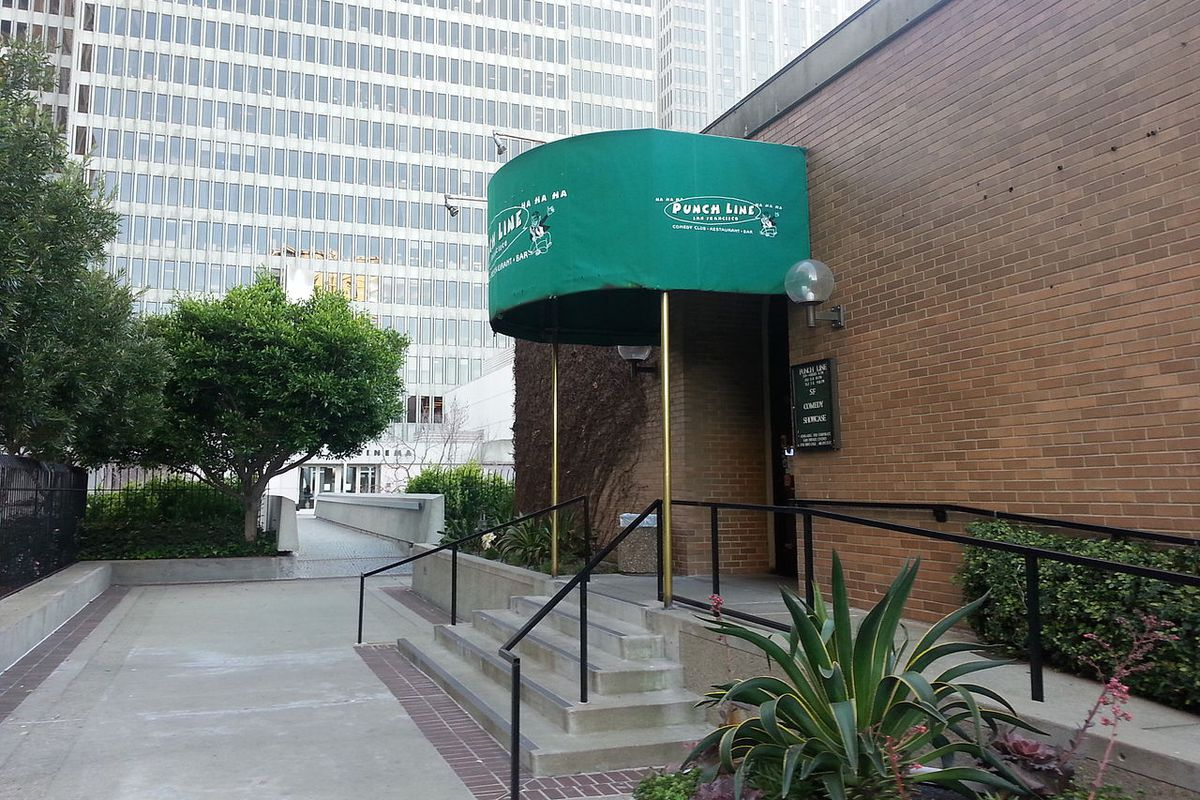 The green awning of the Punch Line comedy club.
