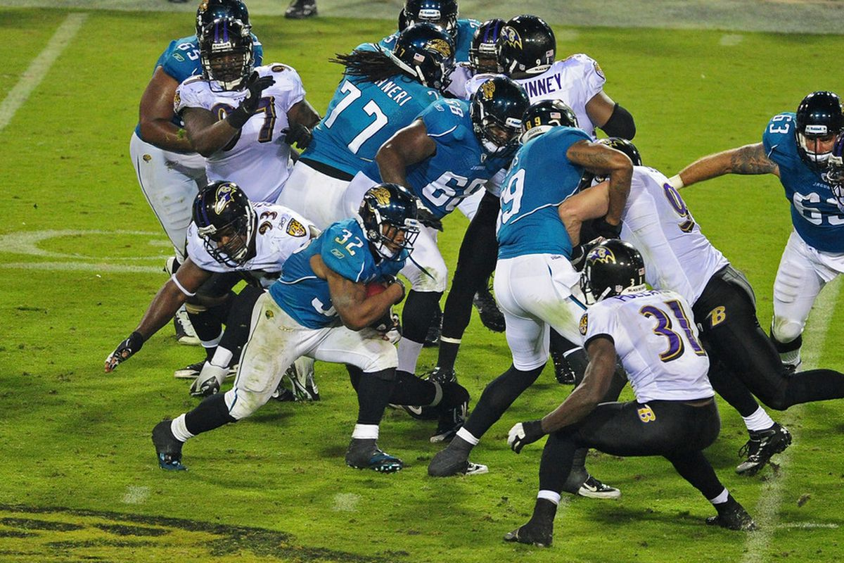 JACKSONVILLE, FL - OCTOBER 24: Maurice Jones-Drew #32 of the Jacksonville Jaguars carries the ball against the Baltimore Ravens at EverBank Field on October 24, 2011 in Jacksonville Florida. (Photo by Scott Cunningham/Getty Images)