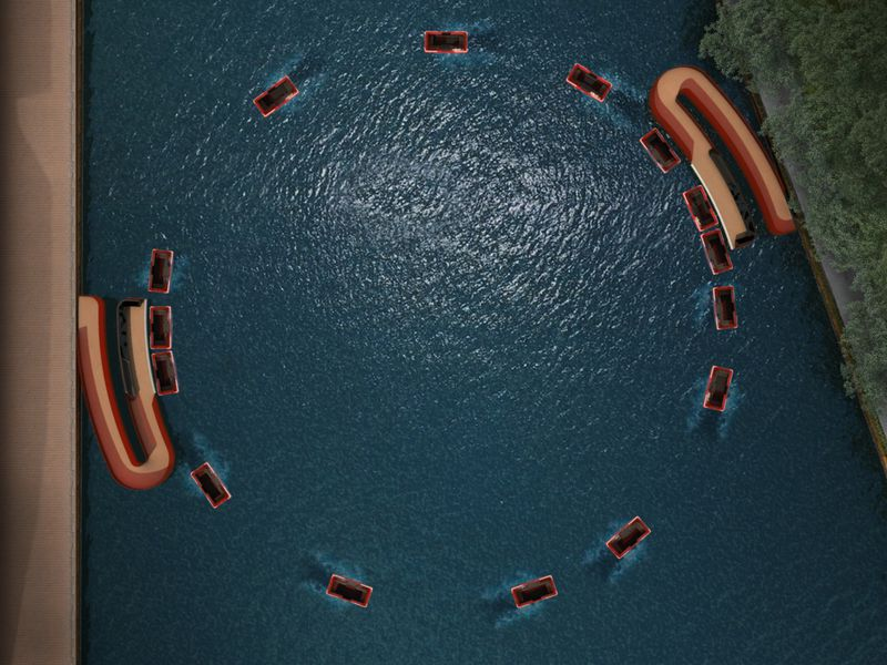 An aerial rendering of boats in the water, traveling in a circle from one side of the dock to the other.