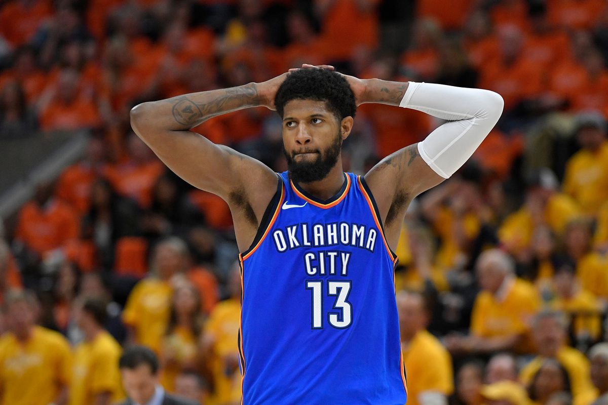 Paul George wearing a blue Oklahoma City jersey no. 13
